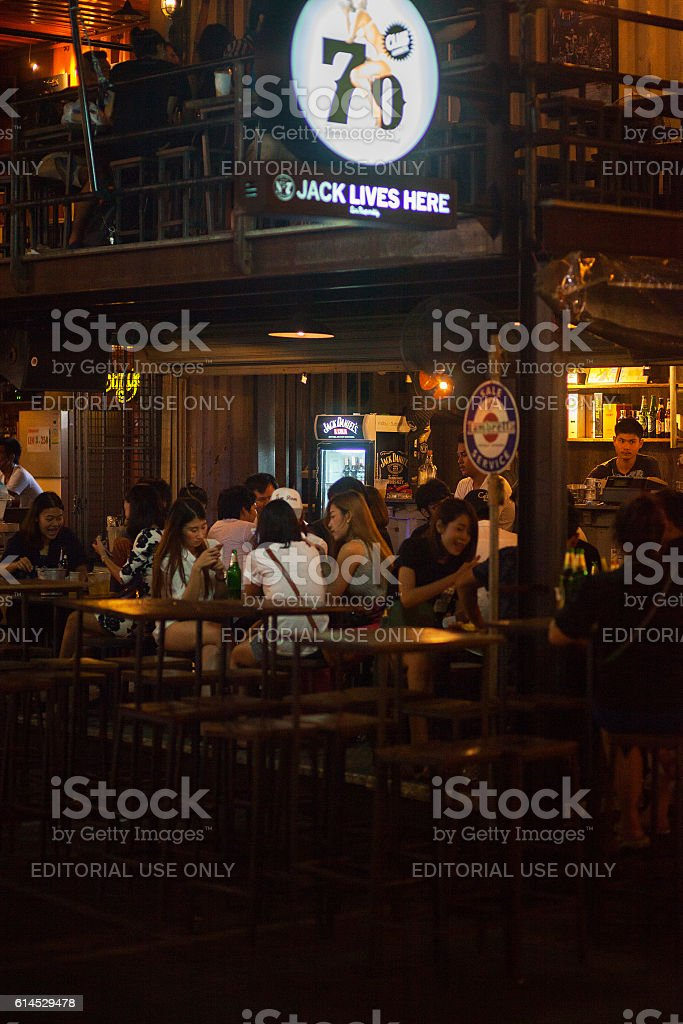 Young thai sitting at bar on train market stock photo