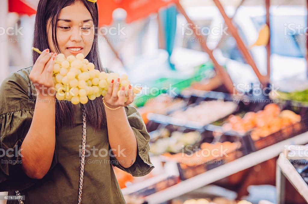 Young Thai Woman Buzing White Grape stock photo