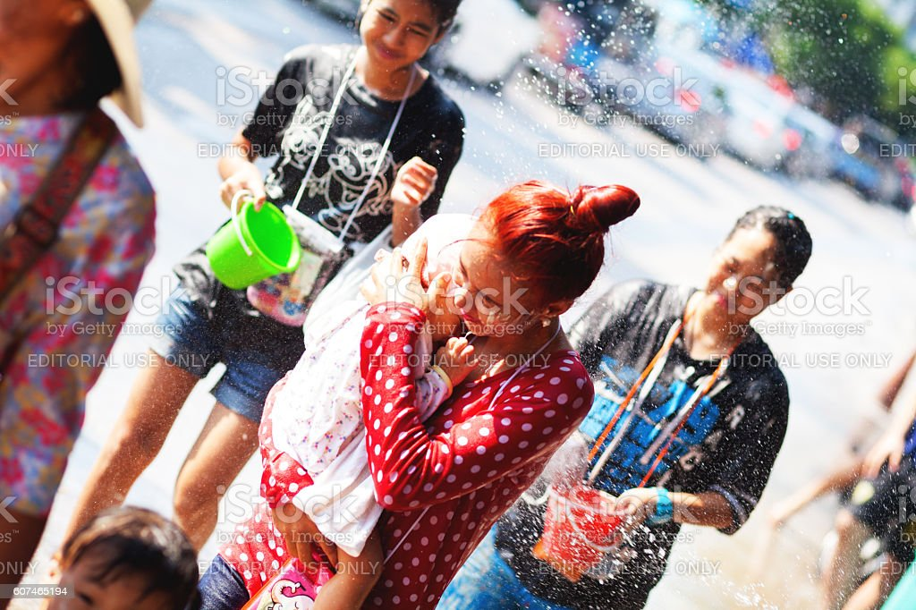 Young thai woman with baby at Songkran stock photo