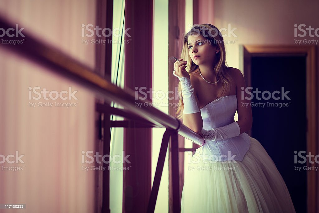 Young tired dancer smoke and dreams about windows royalty-free stock photo