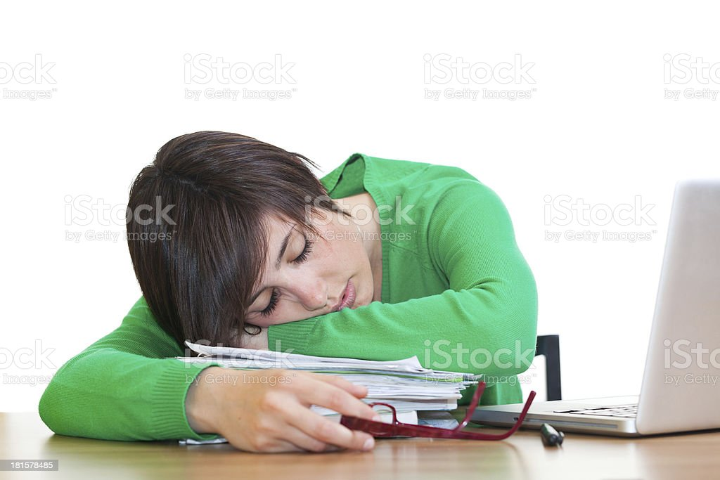 Young Tired Woman Sleeping on Desk at Office royalty-free stock photo