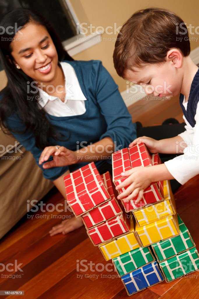 Young Toddler Building Blocks with his Mother or Nanny royalty-free stock photo