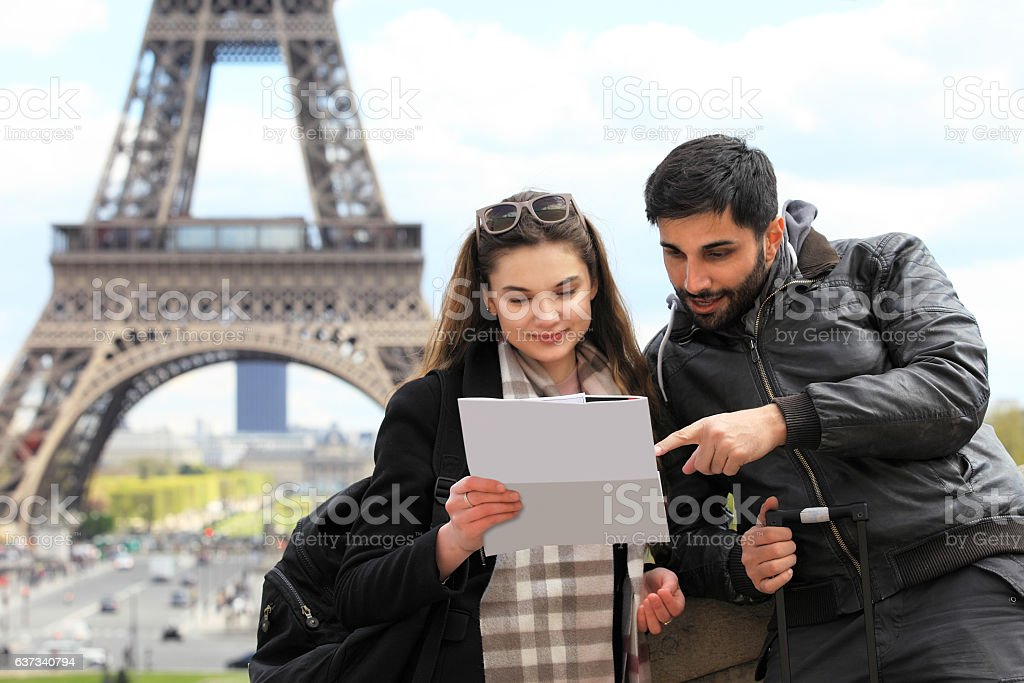 Young tourist couple looking at map stock photo
