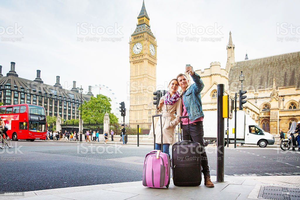 Young tourist couple shoots selfie Big Ben London UK stock photo