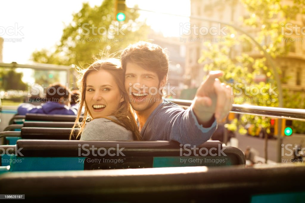 Young Tourist Couple Sightseeing on a Bus stock photo