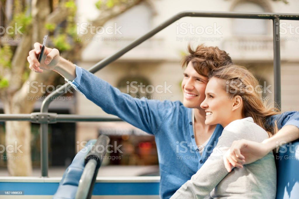 Young Tourist Couple Sightseeing on a Bus royalty-free stock photo