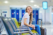 Young tourist girl in international airport