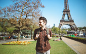 Young tourist man relaxing in Paris