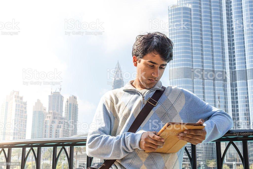 Young Tourist standing near Burj Khalifa in Downtown Dubai stock photo