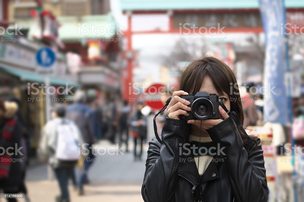Young tourist taking photos in Japanese street stock photo