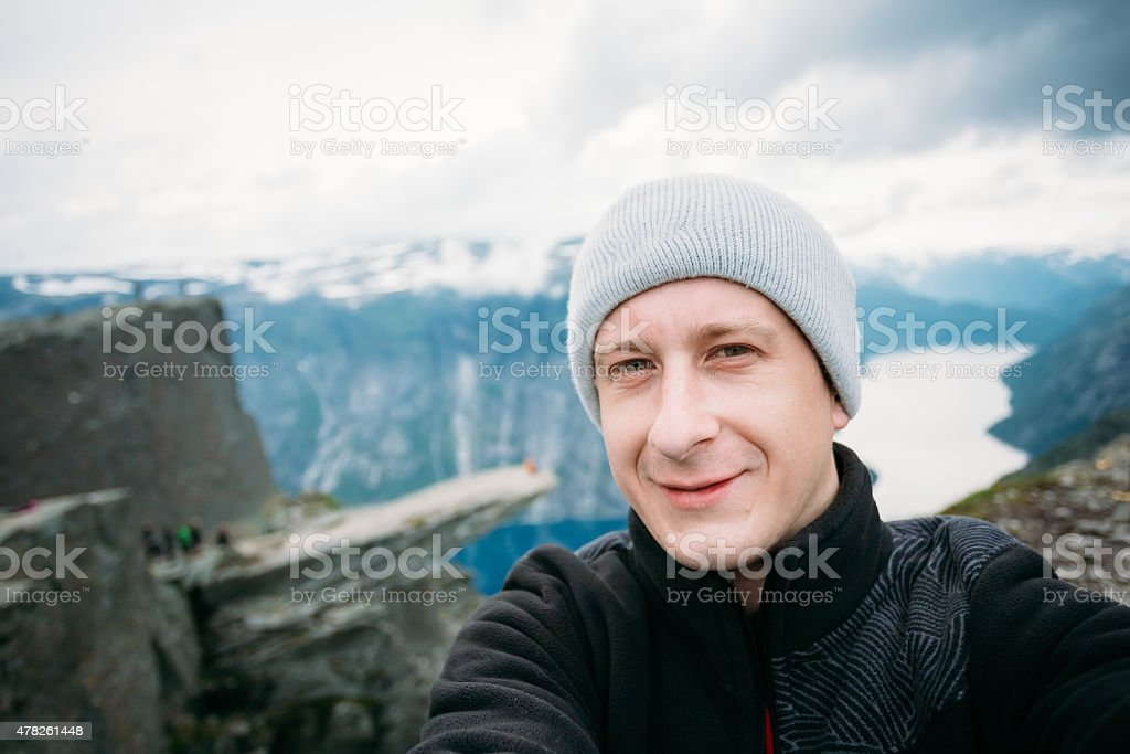 Young Tourist Taking Selfie Against The Backdrop Of The Norwegia stock photo