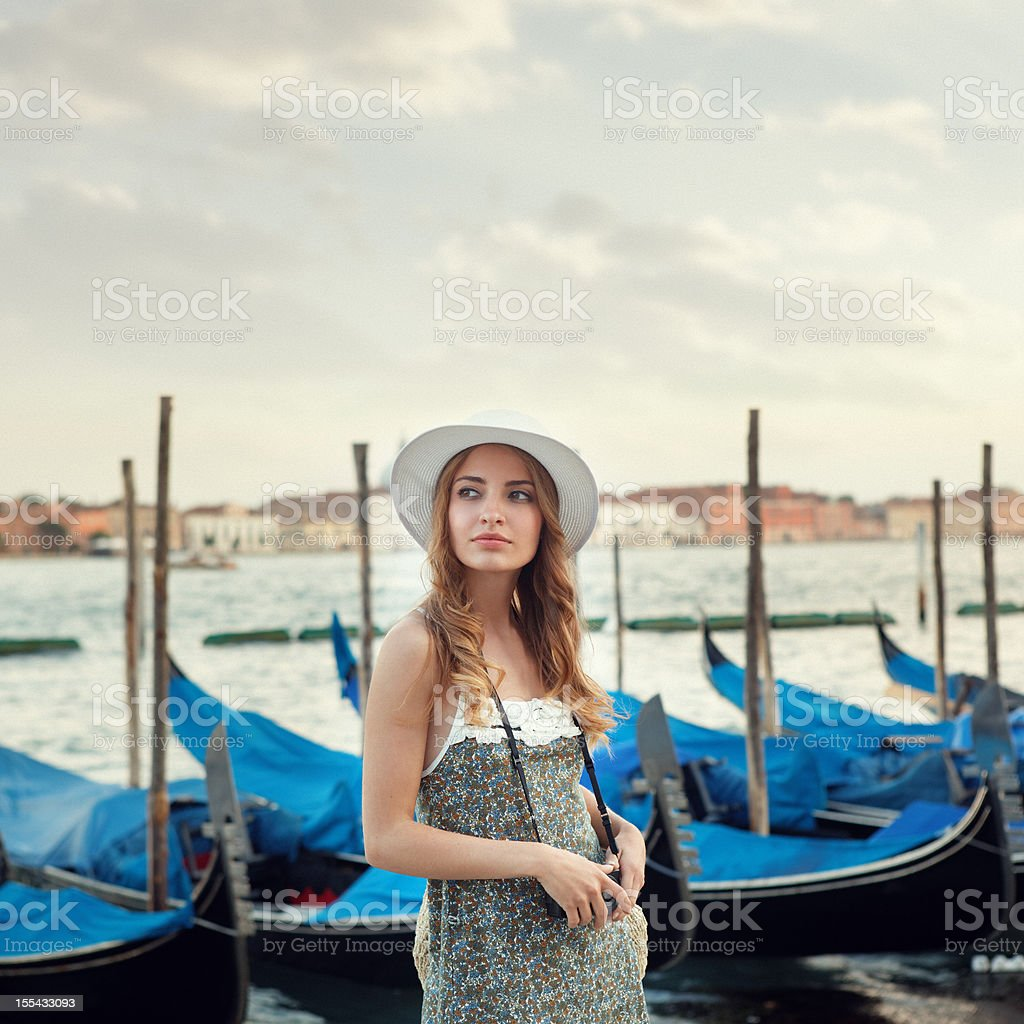 young tourist with camera in Venice royalty-free stock photo