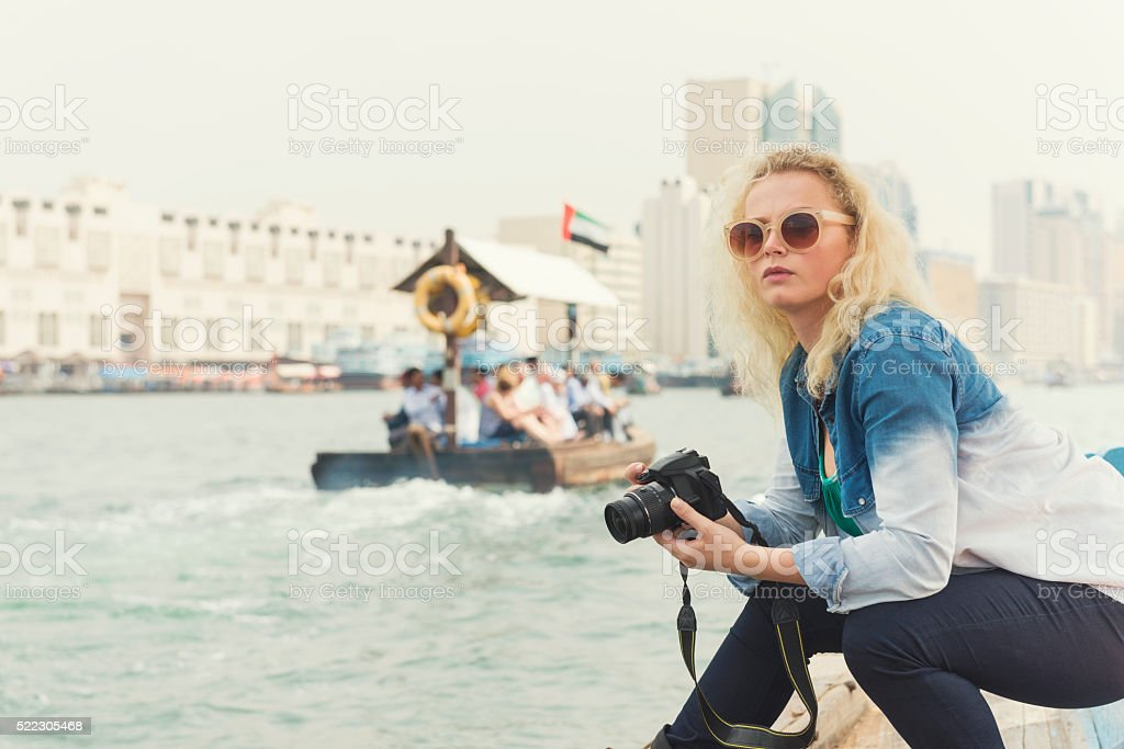 Young tourist woman on abra in Old Dubai stock photo