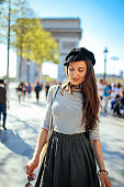 Young tourist woman relaxing in Paris
