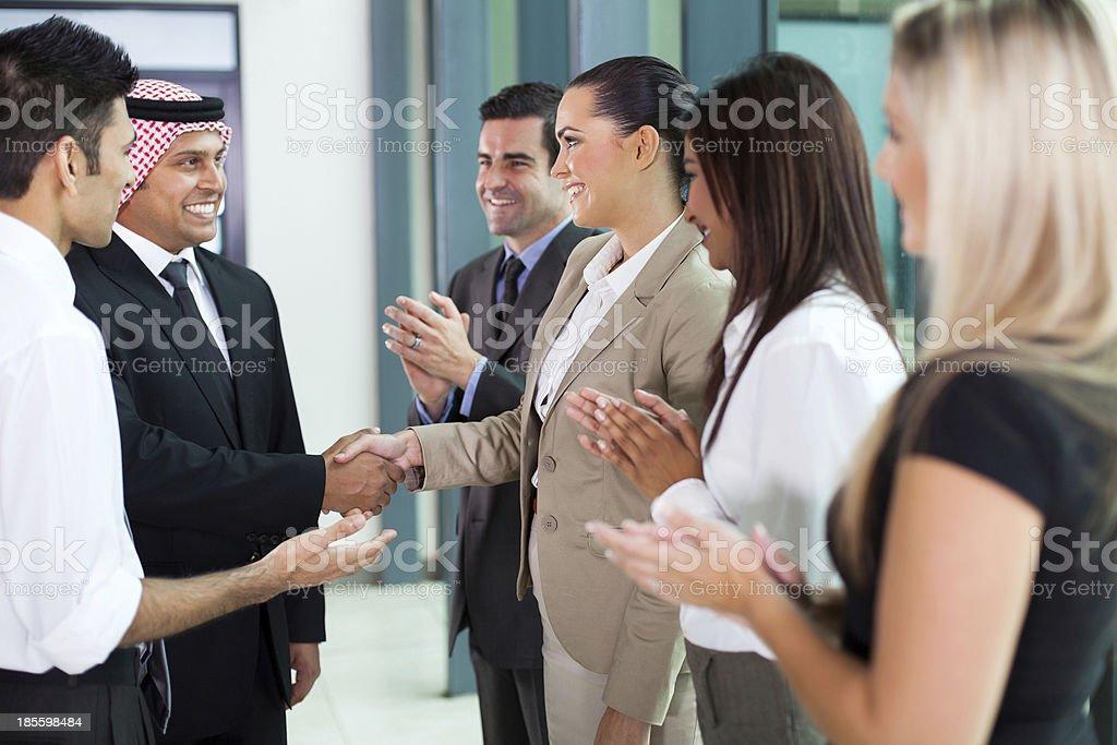 young translator introducing arab businessman stock photo