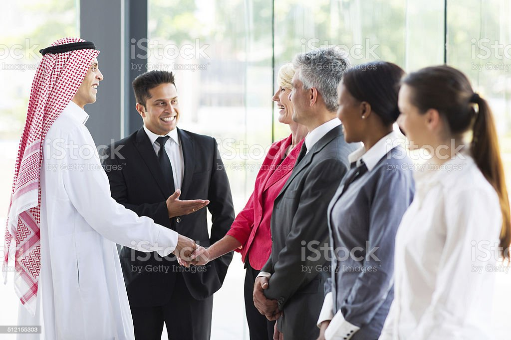 young translator introducing Arabian businessman stock photo