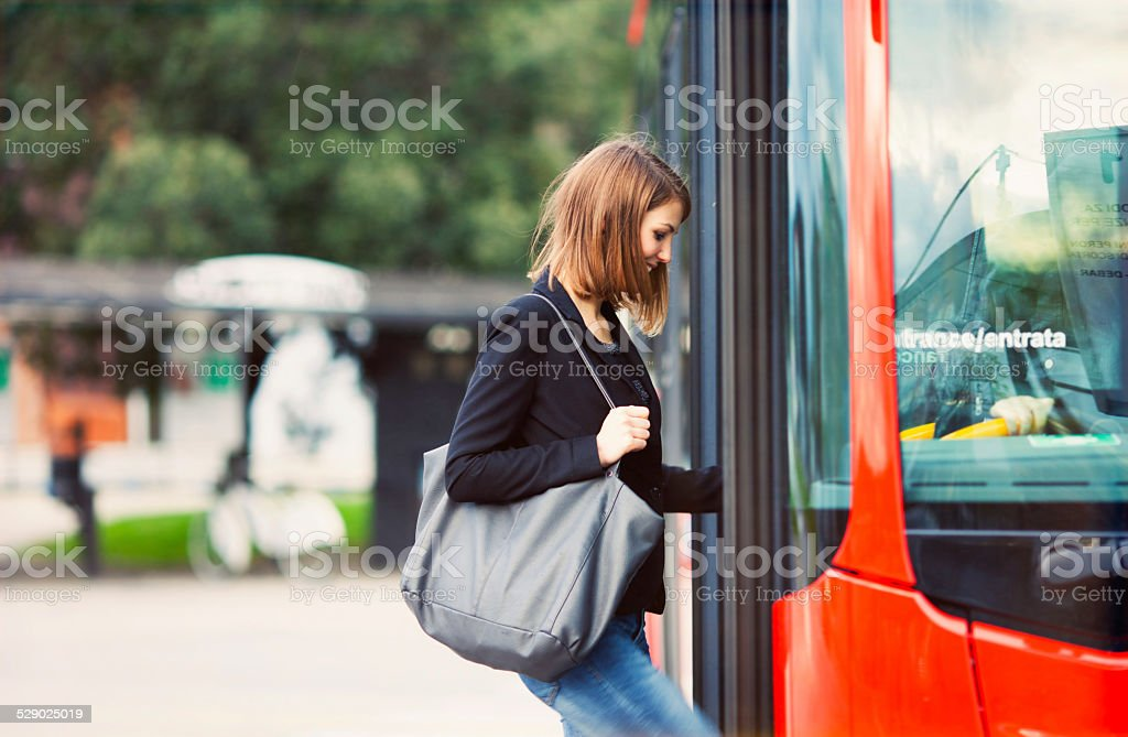 Young traveler boarding a bus stock photo