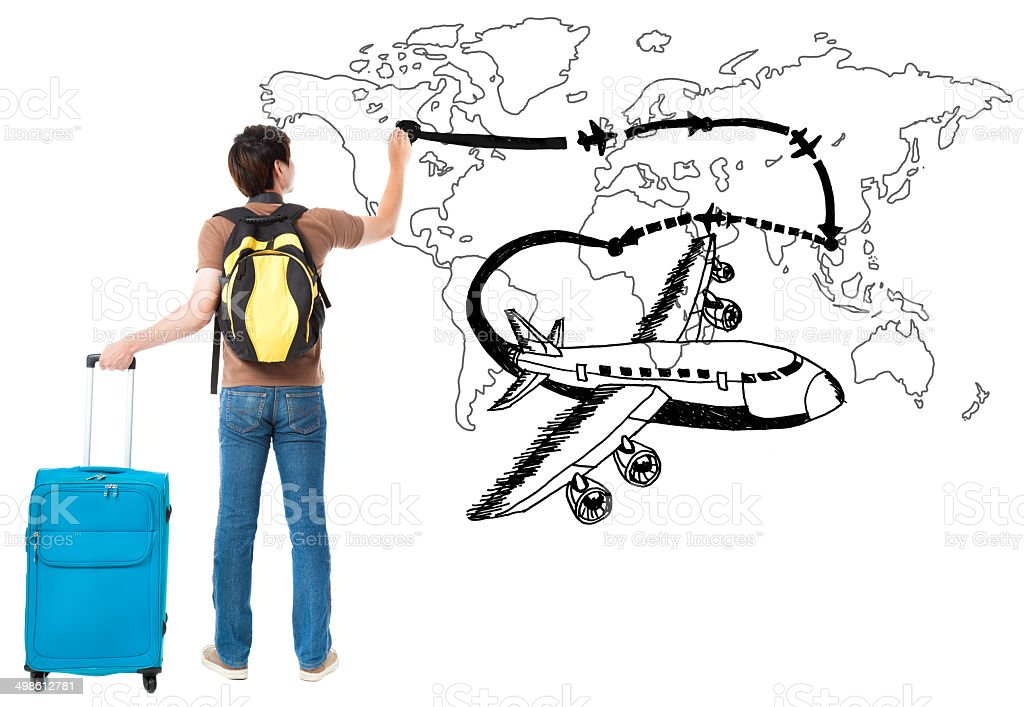 young traveler drawing airplane and airline path on the map stock photo