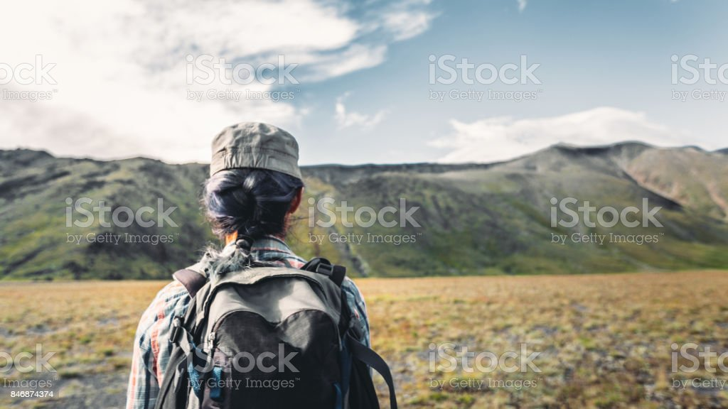Young Traveler Girl With Backpack Is Engaged In Hiking In Mountains, Rear View. Tourism Adventure Lifestyle Concept stock photo