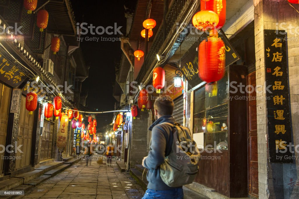 Young traveler man in alley of ancient village, China stock photo