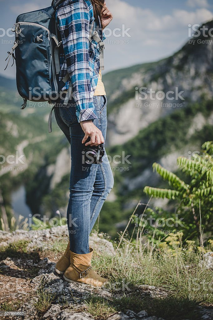Young traveler photographer with photo camera stock photo