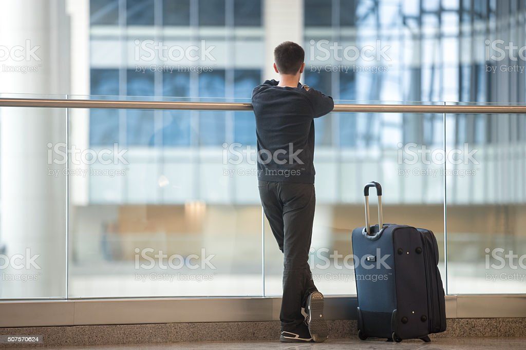 Young traveler waiting for airplane stock photo