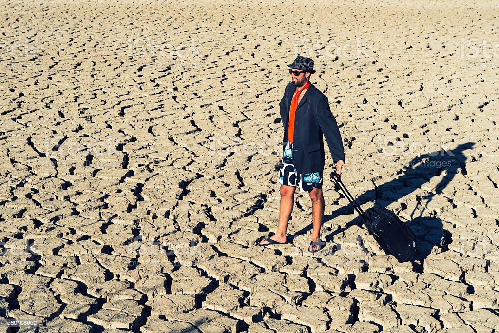 young traveler walking through the desert stock photo