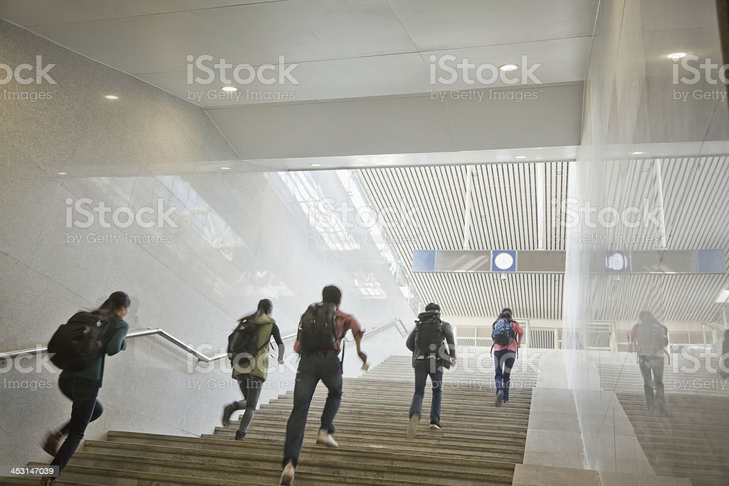Young Travelers Running Up the Stairs stock photo