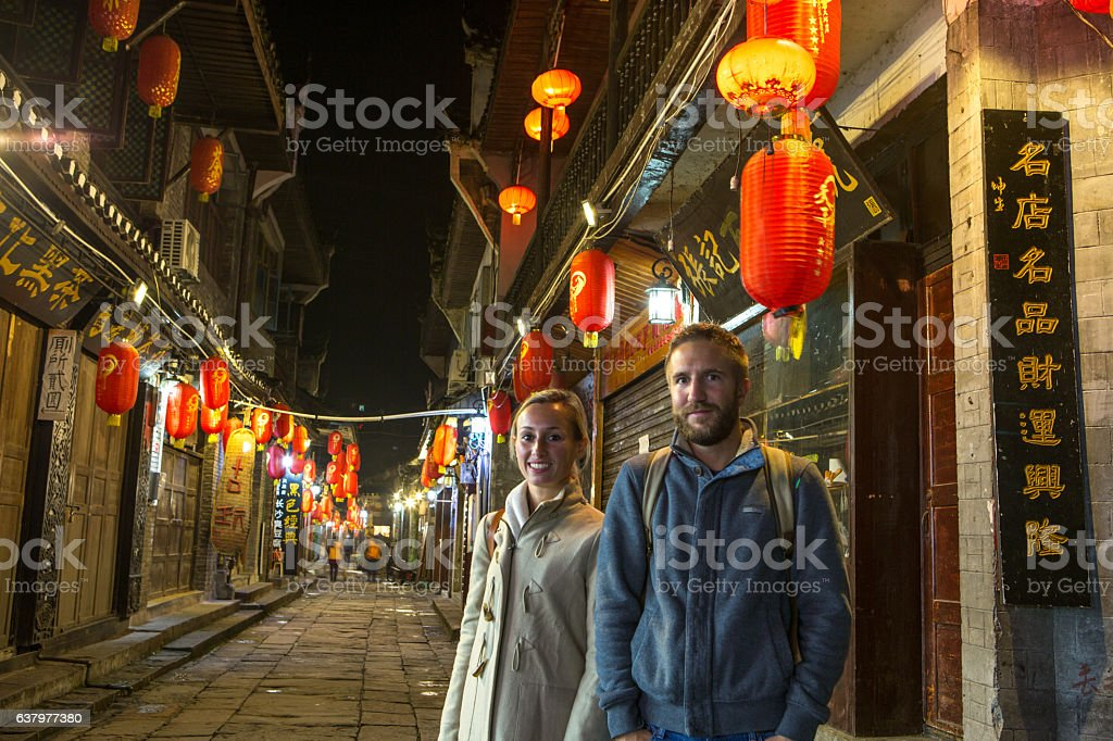 Young traveling couple in ancient village of China stock photo