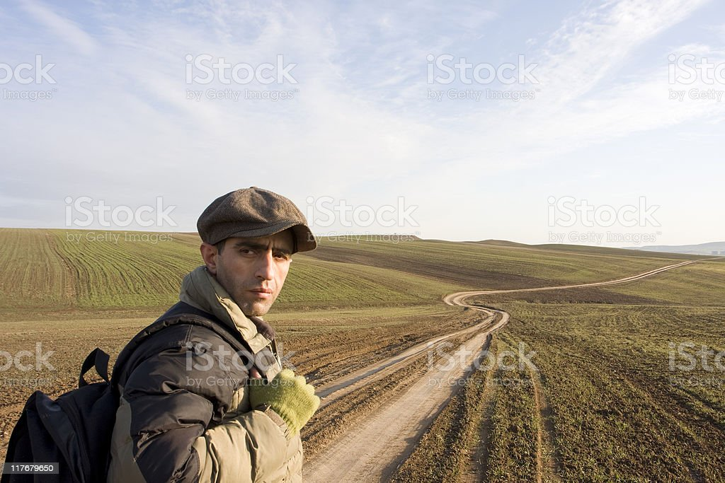 Young Traveller Man On The Country Road royalty-free stock photo