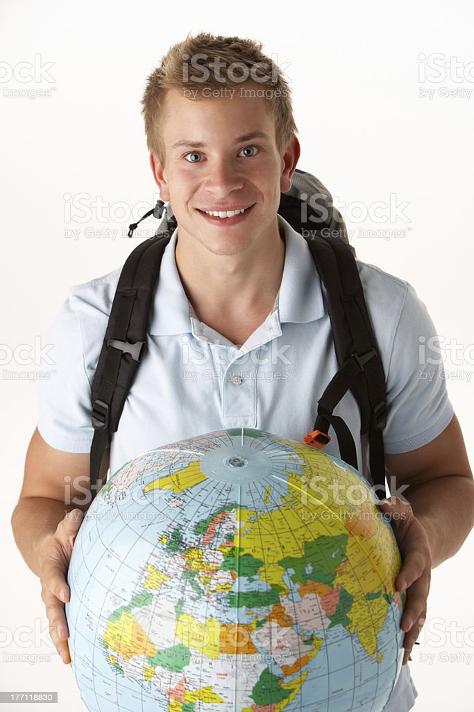 Young traveller with globe stock photo