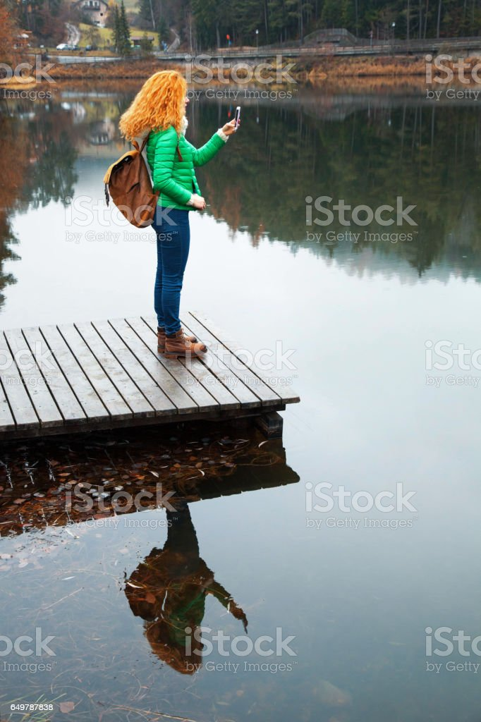 Young traveller women using smartphone stock photo