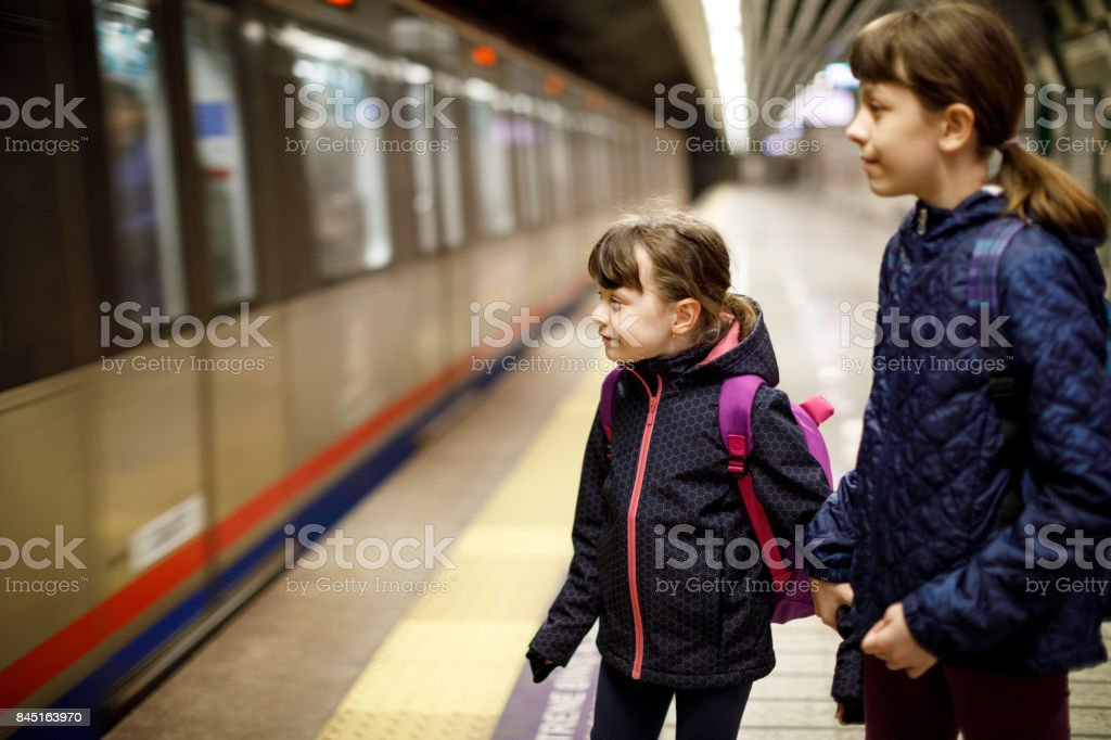 Young travellers waiting for subway train stock photo