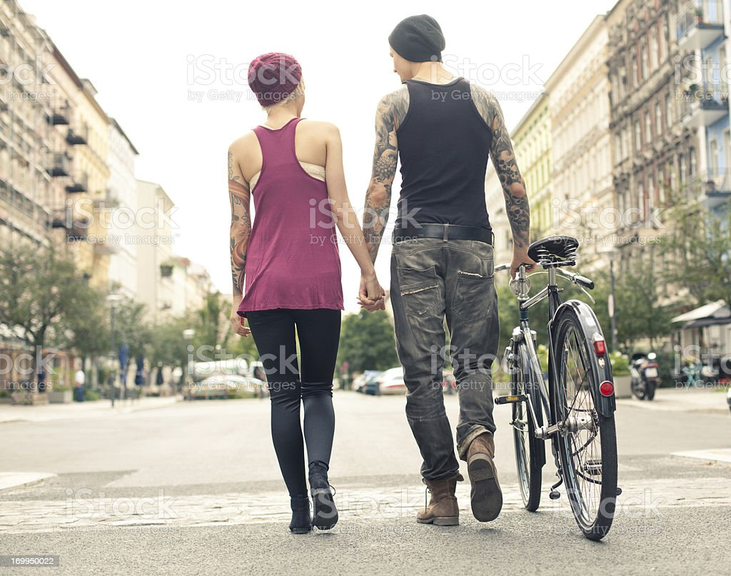 Young trendy couple walking down the streets of Berlin stock photo