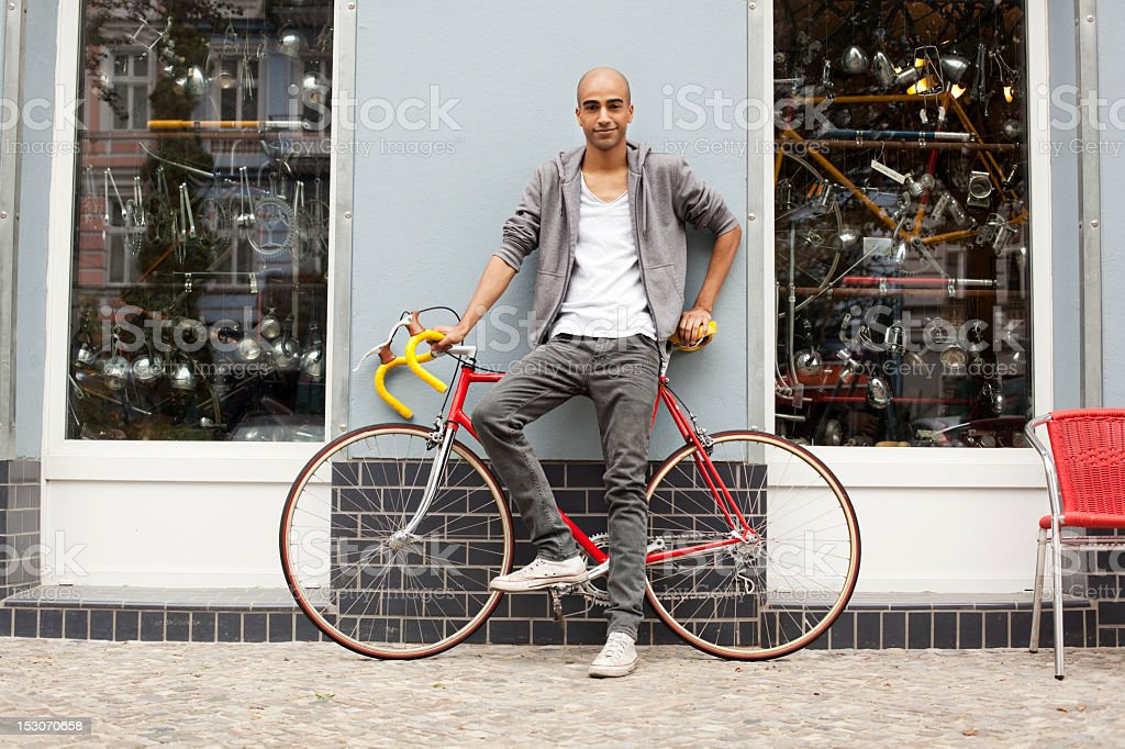 Young trendy guy with a bicycle stock photo