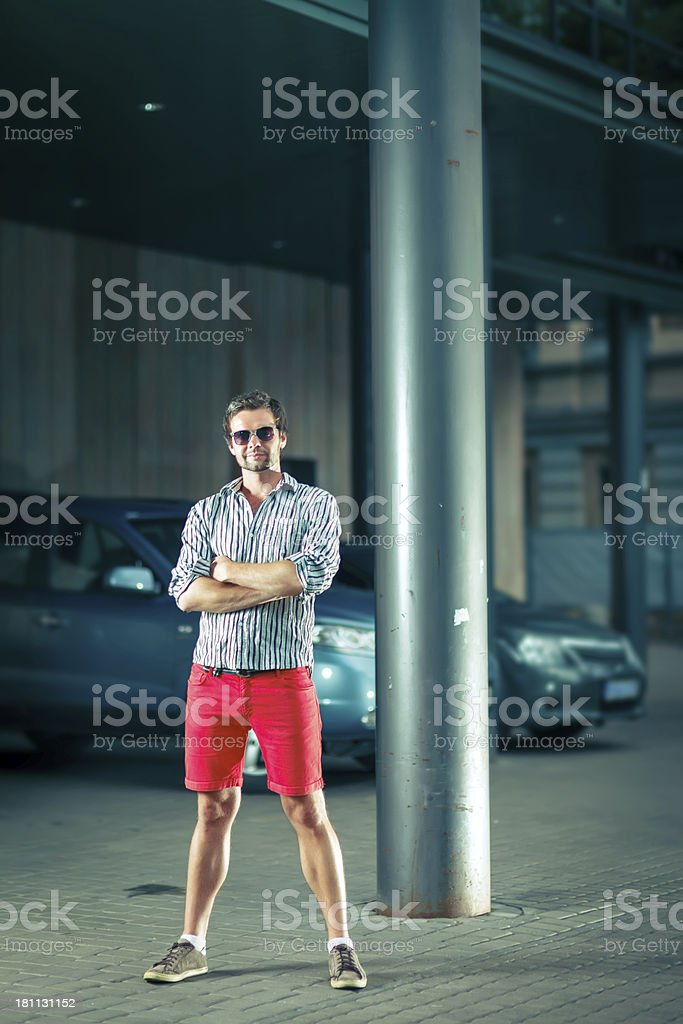 Young trendy man in front of car park royalty-free stock photo