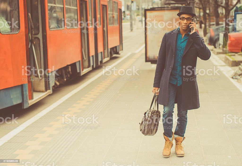 Young trendy man on the mobile phone stock photo