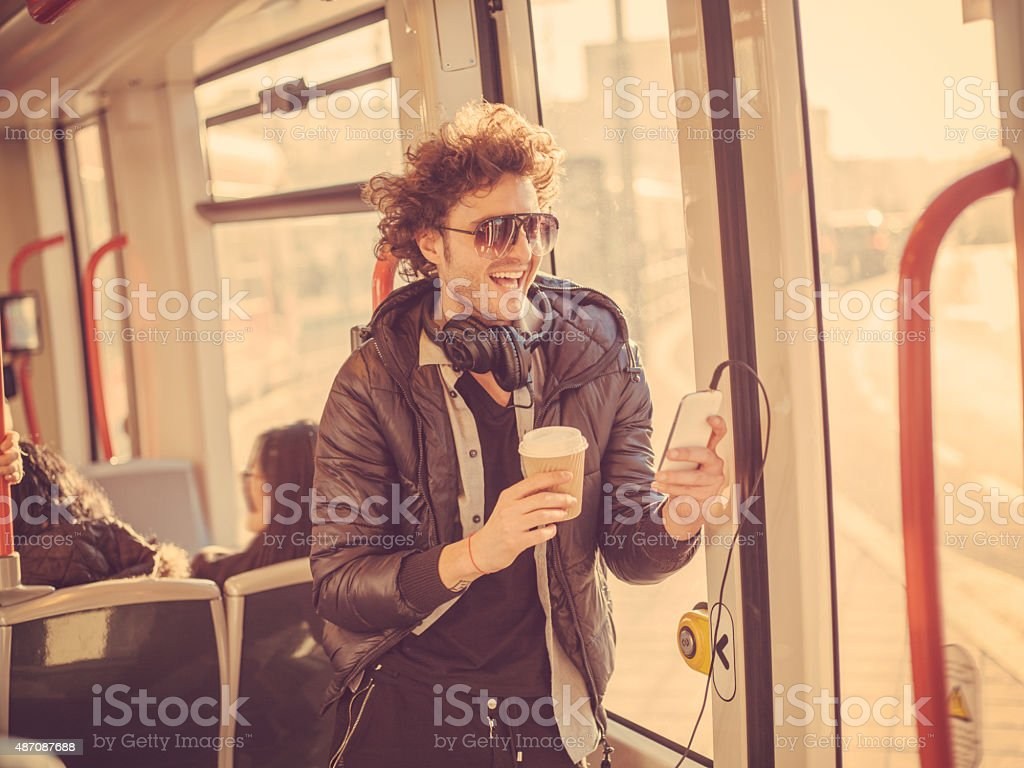 young trendy man using mobile phone stock photo