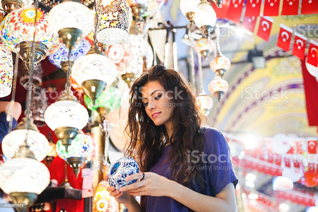Young Turkish Girl Shopping in Grand Market stock photo