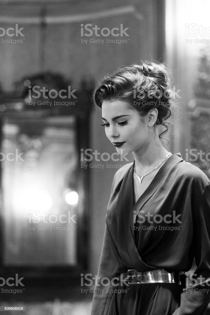 Young ukrainian female modelat historical building in  lviv ukraine stock photo