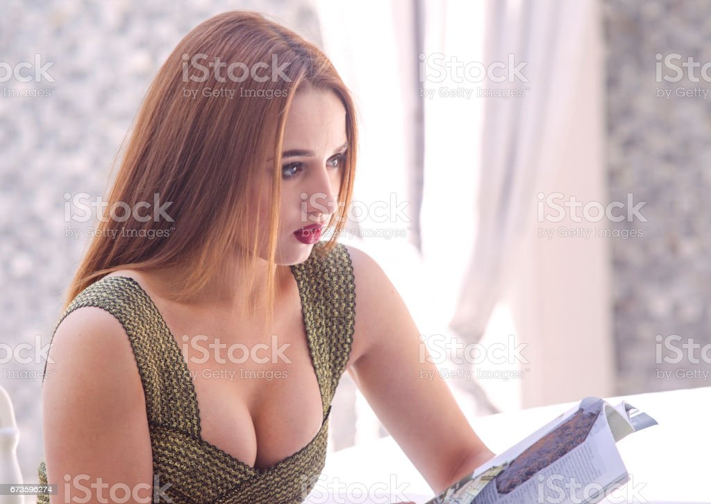 Young ukrainian woman model reading in istanbul Turkey stock photo