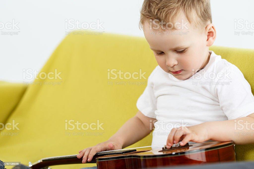 Young ukulele player stock photo