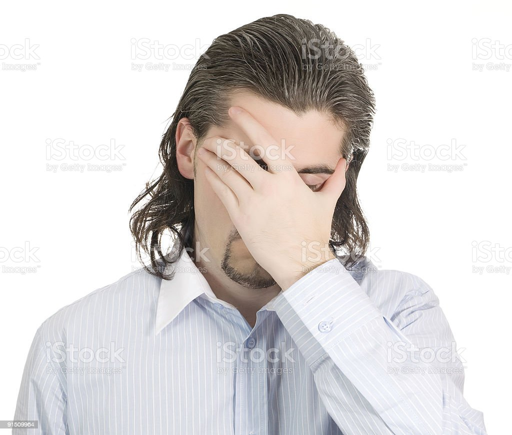 Young unhappy guy covers his eye with hand isolated white stock photo