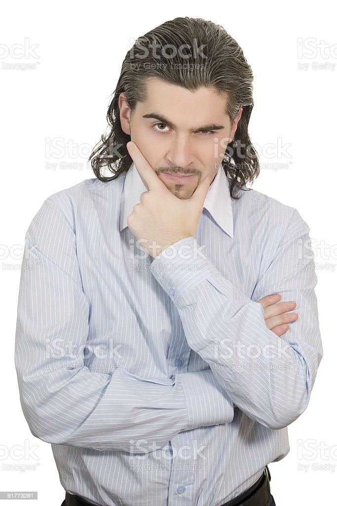 Young unhappy man holds his hand at chin and speculates stock photo