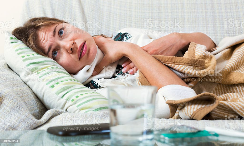 Young unhappy woman having heavy quinsy stock photo