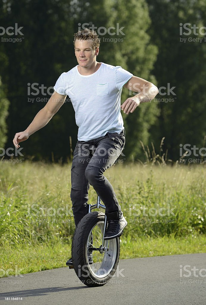 young unicyclist stock photo