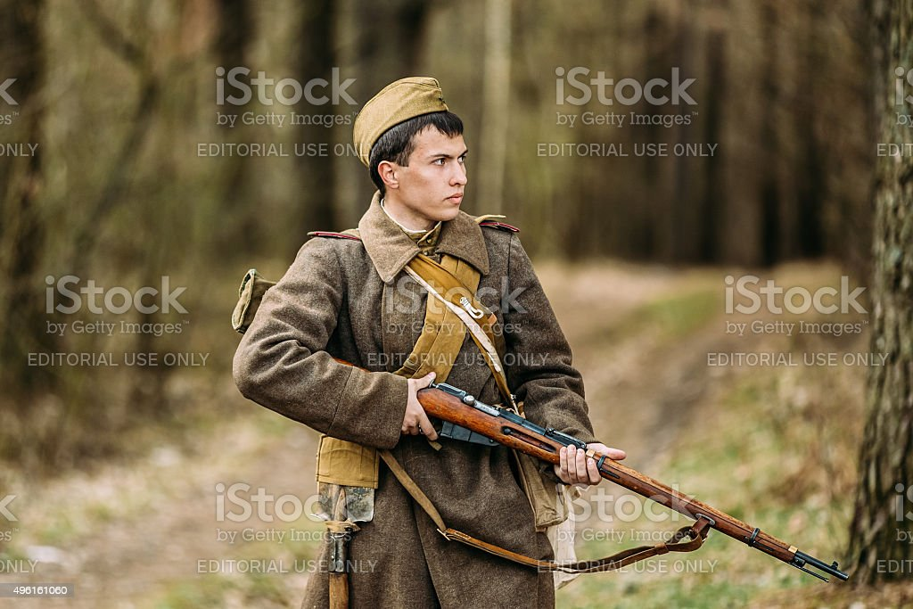 Young unidentified re-enactor dressed as Soviet soldier gunner stock photo