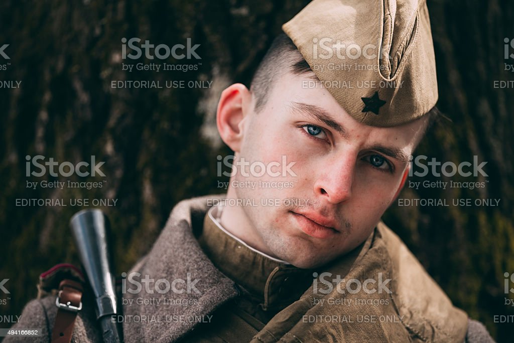 Young unidentified re-enactor dressed as Soviet soldier in over stock photo