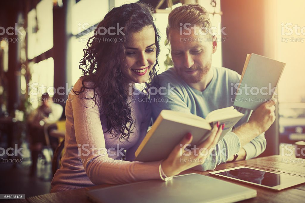 Young university students reading books stock photo