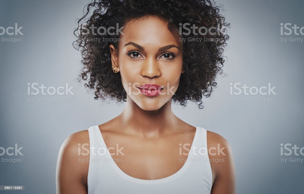 Young upbeat grinning woman stock photo
